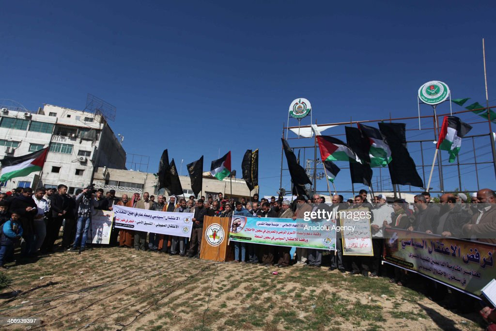 Palestinian Islamic Jihad members wave their flags during a protest for Palestinian prisoners at Israel prison in Gaza City, Gaza, on February 5, 2014.