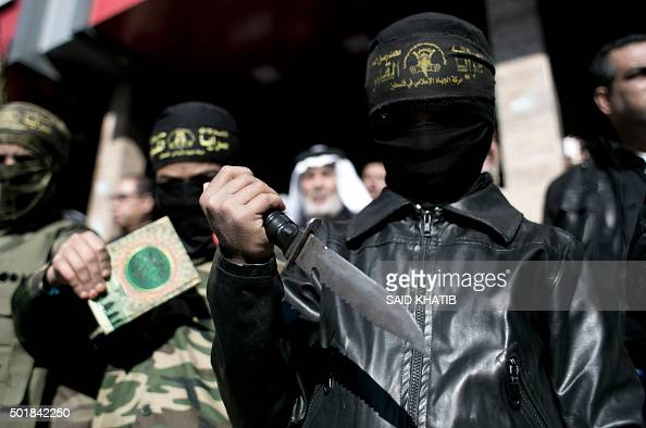 Palestinian Islamic Jihad militants take part in an antiIsrael rally in the town of Rafah in the southern Gaza Strip on December 18 2015 A wave of...