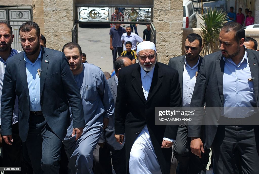 Palestinian Islamist movement Hamas' chief, Ismail Haniya arrives at a mosque after giving a speech during the Friday prayer on May 6, 2016 in Deir al-Balah, in the center of the Gaza Strip. / AFP / MOHAMMED