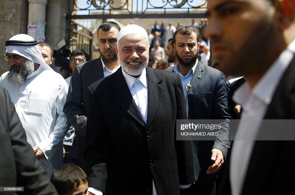 Palestinian Islamist movement Hamas' chief, Ismail Haniya leaves a mosque after giving a speech during the Friday prayer on May 6, 2016 in Deir al-Balah, in the center of the Gaza Strip. / AFP / MOHAMMED