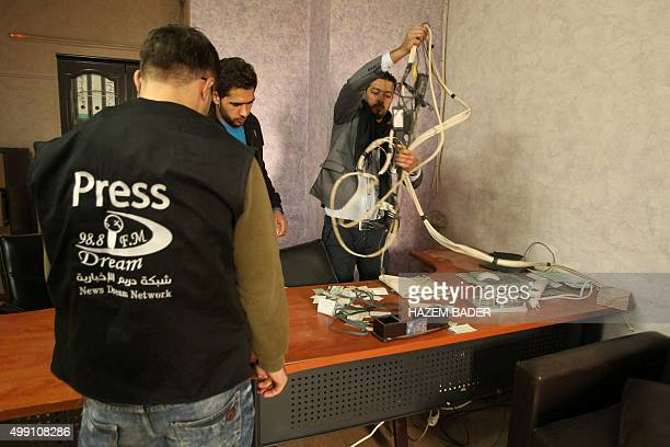 Palestinian journalists check the damage after Israeli security forces entered the offices of the local Palestinian Dream radio and handed the...