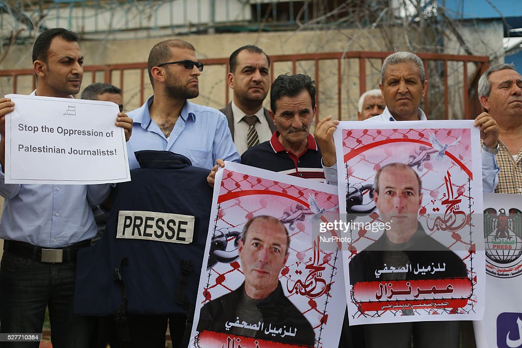 Palestinian Journalists hold banners during a protest calling for stop the Israeli violence against journalists to mark the World Press Freedom Day, in front of the headquarter United Nation ''UNSCO'' in Gaza City, on May 3, 2016.