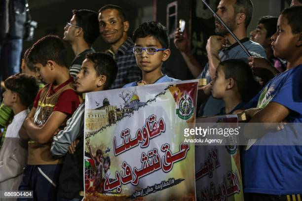 Palestinian kid holds a banner during a demonstration over US President Donald Trump 'terror' label for Hamas movement in Jabalia West Bank on May 22...