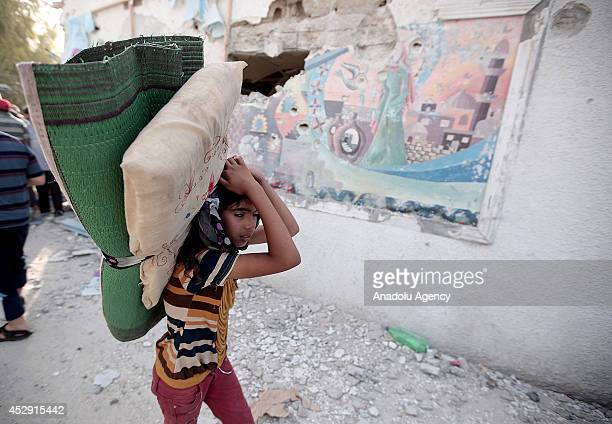 Palestinian kid is seen in Abu Hussein School which was sheltering dozens of displaced Palestinians run by UNRWA hit by a Israeli tank shell attack...