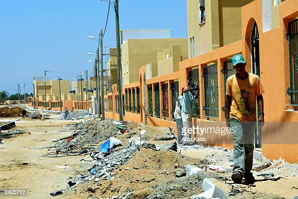 Palestinian laborers work on the construction of new houses sponsored by the United Nations Relief and Works Agency for Palestinian refugees in the...