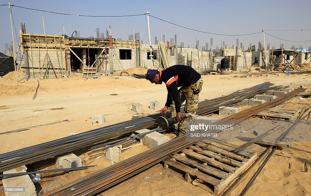 A Palestinian labourer works at the construction site of a residential project funded by the United Nations Relief and Works Agency for Palestine Refugees (UNRWA) in Rafah in the southern Gaza Strip on January 17, 2013. The European Union said it was speeding up disbursement of aid to help ensure there is no interruption in its support for the Palestinian Authority and UN refugee programmes.