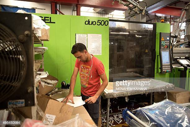 A Palestinian labourer works at the Israeli Lipski plastic factory at the Barkan Industrial Park near the Israeli settlement of Ariel in the occupied...