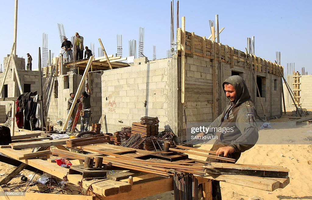 Palestinian labourers work at the construction site of a residential project funded by the United Nations Relief and Works Agency for Palestine Refugees (UNRWA) in Rafah in the southern Gaza Strip on January 17, 2013. The European Union said it was speeding up disbursement of aid to help ensure there is no interruption in its support for the Palestinian Authority and UN refugee programmes. AFP PHOTO / SAID KHATIB