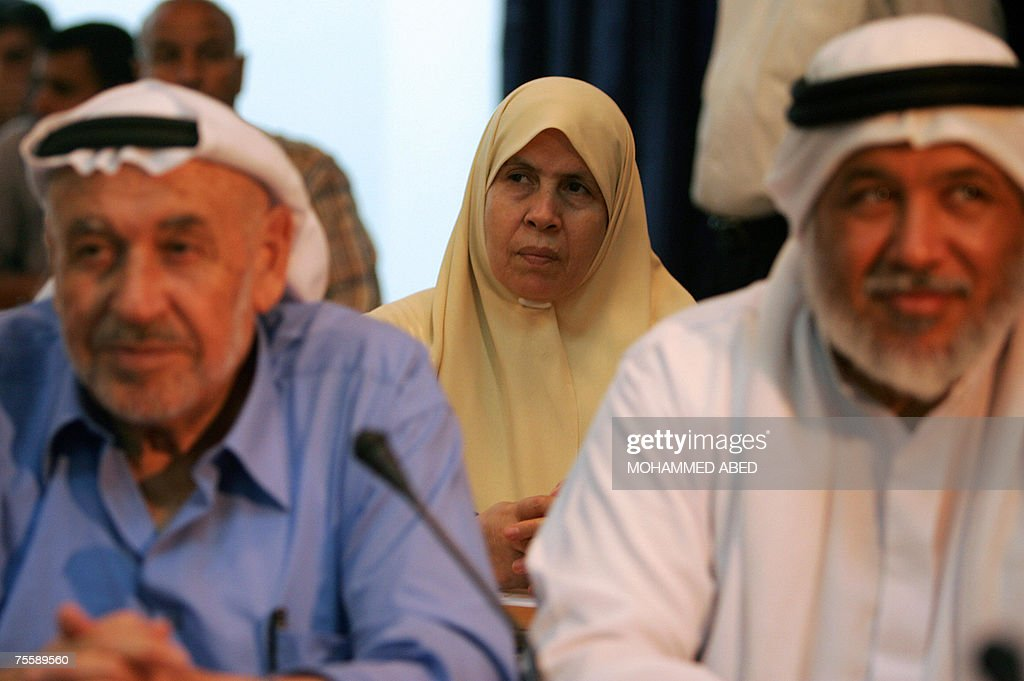 Palestinian lawmaker Mariam Farhat (C) of Hamas attends a parliament session in Gaza City, 22 July 2007. The Palestinian parliament failed to convene again today, further entrenching the political stalemate in the wake of last month's bloody takeover of the Gaza Strip by the Islamist Hamas. Only 10 lawmakers showed up for the session in Ramallah and 23 in Gaza, deputy speaker Hassan al-Qureishi said. Sixty-seven lawmkers in the 132-member need to be present for quorum. AFP PHOTO/MOHAMMED ABED