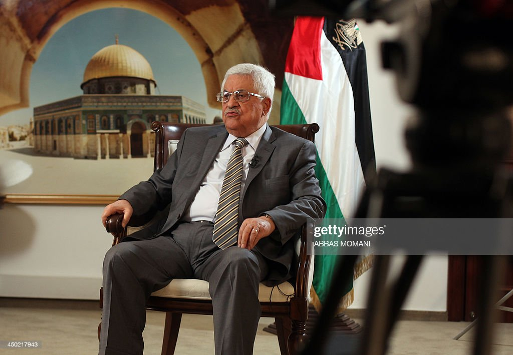 Palestinian leader Mahmud Abbas speaks during an exclusive interview with AFP at the Muqata, the Palestinian Authority headquarters, on November 17, 2013 in the West Bank city of Ramallah. Abbas called for an international inquiry to decide who was responsible for the death of Yasser Arafat after scientists said it was likely he was poisoned.