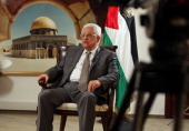 Palestinian leader Mahmud Abbas speaks during an exclusive interview with AFP at the Muqata the Palestinian Authority headquarters on November 17...