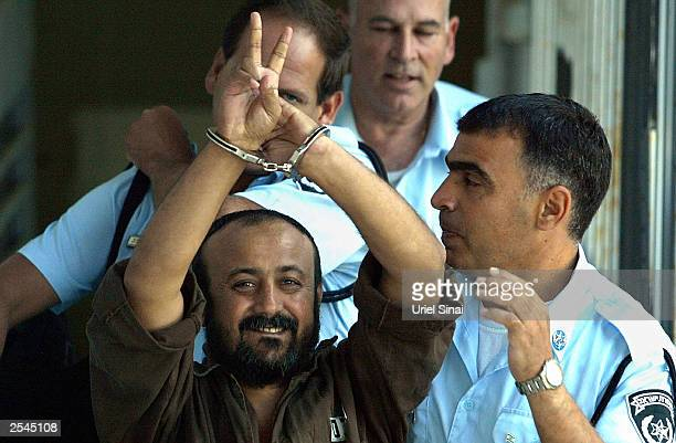 Palestinian leader Marwan Barghouti is taken away under escort September 29 2003 in Tel Aviv Israel after continued proceedings in his trial in the...