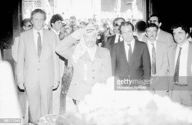 Palestinian leader of Palestine Liberation Organization Yasser Arafat and Italian politicians Achille Occhetto and Massimo D'Alema paying tribute to...