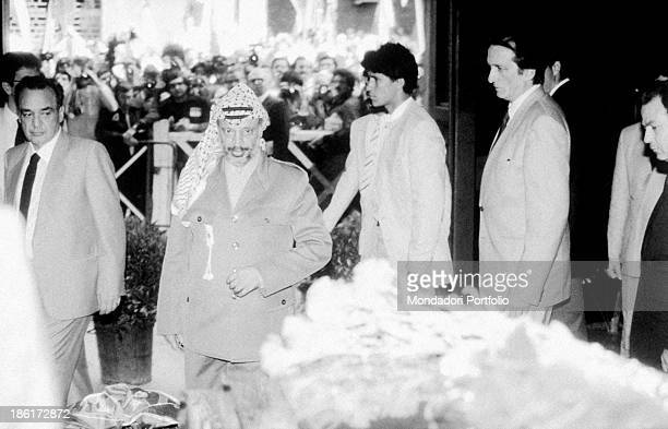 Palestinian leader of Palestine Liberation Organization Yasser Arafat paying tribute to the coffin of the General Secretary of the Italian Communist...
