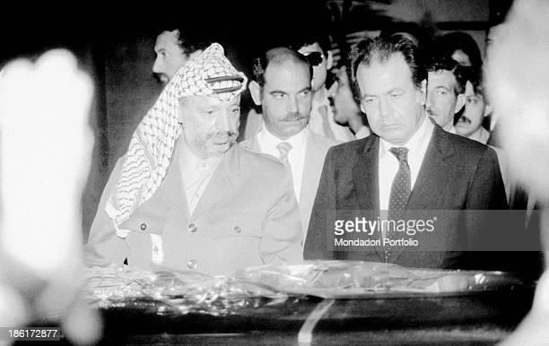 Palestinian leader of Palestine Liberation Organization Yasser Arafat and delegate of Palestine Liberation Organization Hammad Nemer paying tribute...