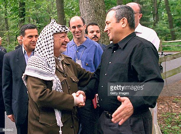 Palestinian leader Yasser Arafat greets Israeli Prime Minister Barak July 11 2000 at Camp David MD The US President carries his Middle East summit...