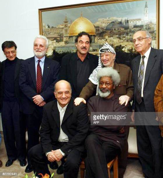 Palestinian leader Yasser Arafat poses with a group of international intellectuals on a factfinding mission in the Palestinian territories at his...