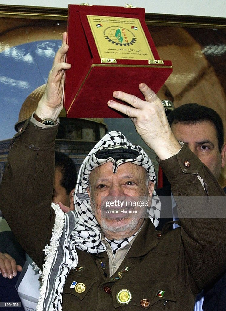 palestinian leader yasser arafat Palestinian leader yasser arafat kisses a boy during a meeting with young palestinians at his office in the west bank city of ramallah 13 august 2004 palestinian.