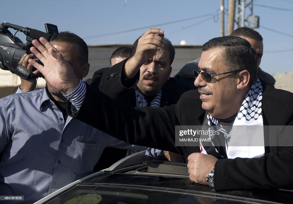Palestinian Legislative Council member and Fatah movement leader, Majed Abu Shamala (R), is welcomed by supporters as he arrives in the Gaza Strip after crossing the Erez crossing with Israel on January 21, 2014 in Beit Hanun, northern Gaza Strip. Three Fatah leaders arrived in the Gaza Strip after an announcement by rival faction Hamas that it would allow Fatah members who fled the strip in 2007 to return to the Gaza Strip.