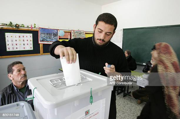 A Palestinian man casts his ballot for the Palestinian elections at a polling station in Sheikh Saad a district of East Jerusalem 25 January 2006...