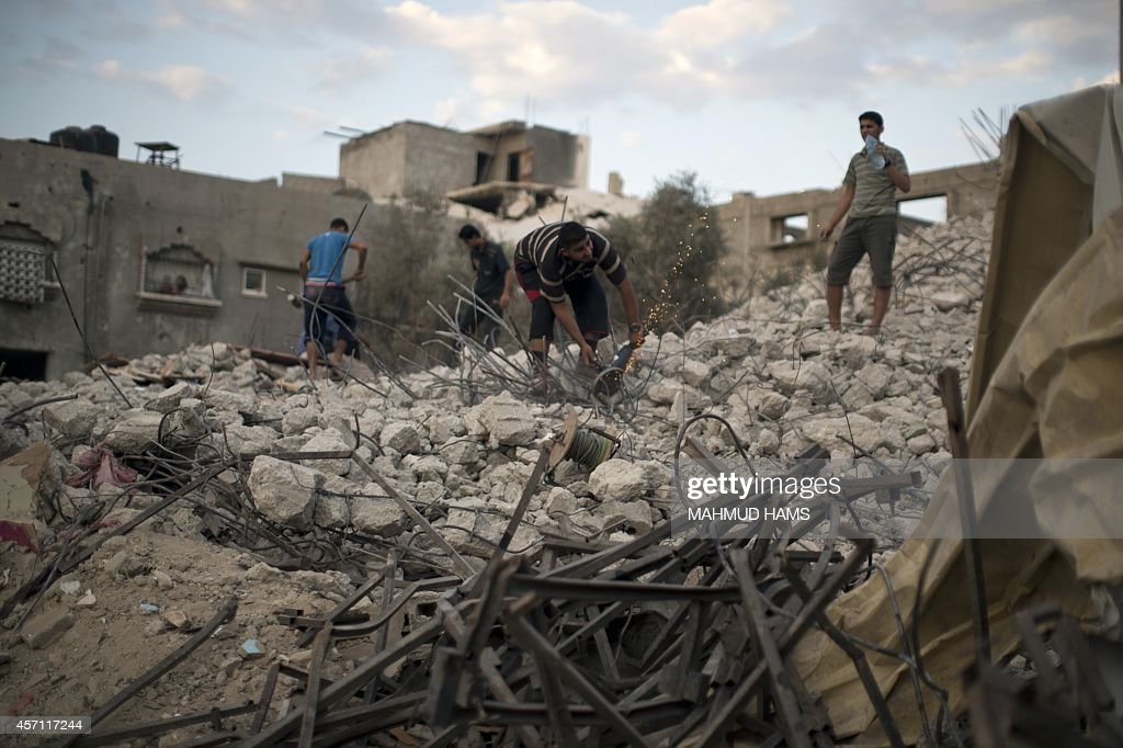 A Palestinian man clears the debris of his house destroyed during the 50day conflict between Hamas militants and Israel in Shejaiya neighbourhood in...