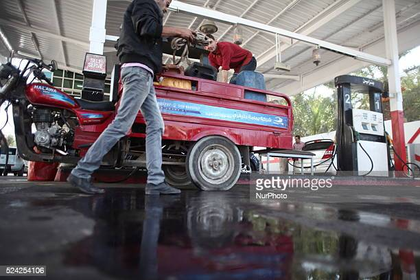 A Palestinian man fills containers with fuel from a petrol station in Gaza city 24 October 2013 Reports state that Gaza officials have said the...