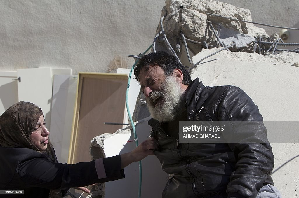 A Palestinian man from the Beshr family cries as he sits on the debris of his house after it was demolished by Israeli authorities who said it was built without municipal permission on February 5, 2014 in the Arab east Jerusalem neighborhood of Jabel Mukaber. Israel pushed forward with plans for more than 550 new homes in three settlement neighbourhoods of annexed east Jerusalem, the city council said.