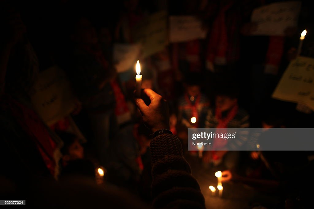 A Palestinian man holds a candle during a protest to resolve Gaza power crisis organized by the Democratic Front for the Liberation of Palestine in...