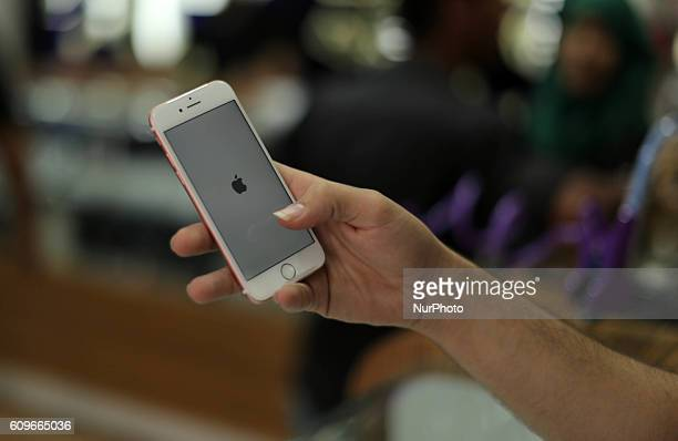 A Palestinian man holds Apple's new iPhone 7 at a mobile phone store in Gaza City on September 22 2016 Apple's new iPhone 7 is selling well in the...