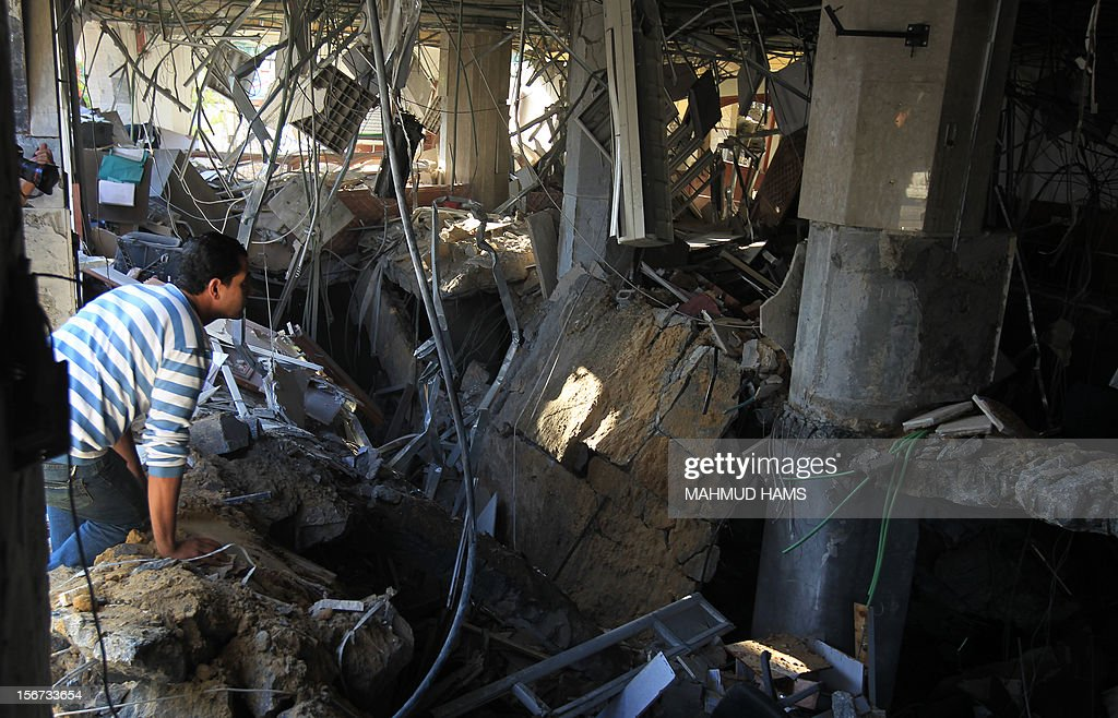 A Palestinian man inspects a destroyed branch of the Islamic National Bank following an Israeli air strike in Gaza City, on November 20, 2012. Seven Palestinians were wounded in strikes on Gaza overnight, but no one was killed in the first night without fatalities since the Israeli air campaign began nearly a week ago.