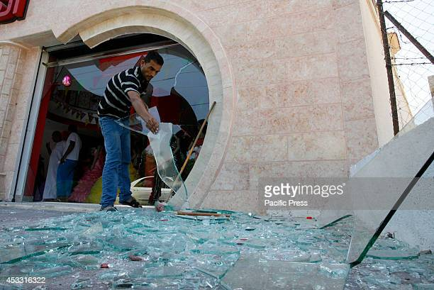 Palestinian man inspects the damage to his shop which sells women's clothing in Rafah town in the Southern Gaza Strip during the 72hour truce Israel...