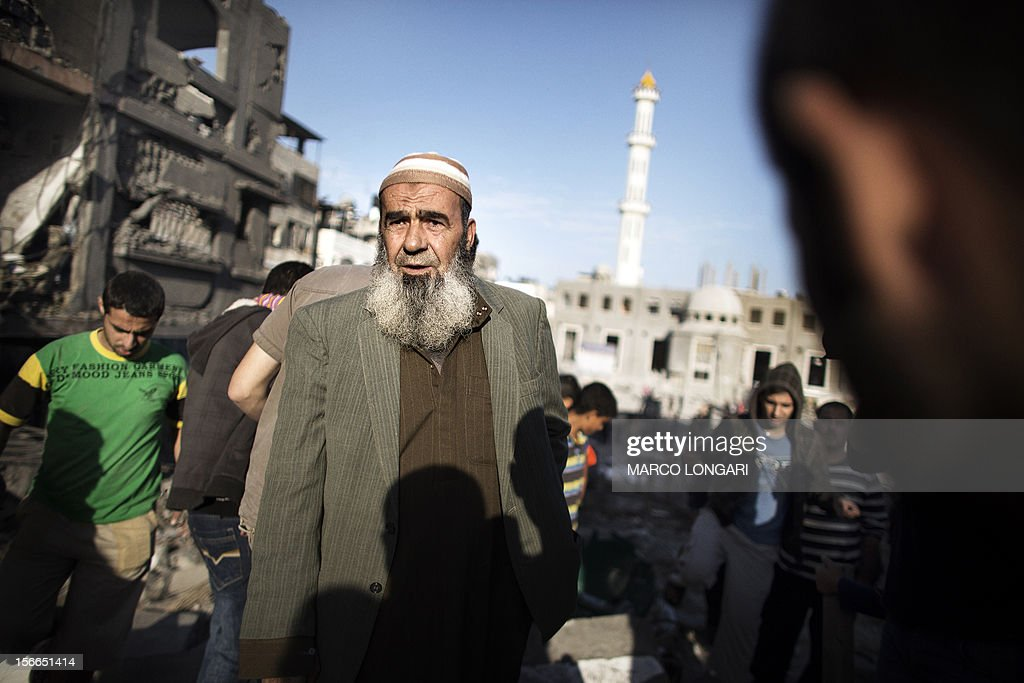 A Palestinian man inspects the damages of a house following an Israeli air strike on the village of Beit Lahia in the northern Gaza Strip on November 18, 2012. Israeli war planes hit a Gaza City media centre and homes in northern Gaza in the early morning, as the death toll mounted, despite suggestions from Egypt's President Mohamed Morsi that there could be a 'ceasefire soon.'
