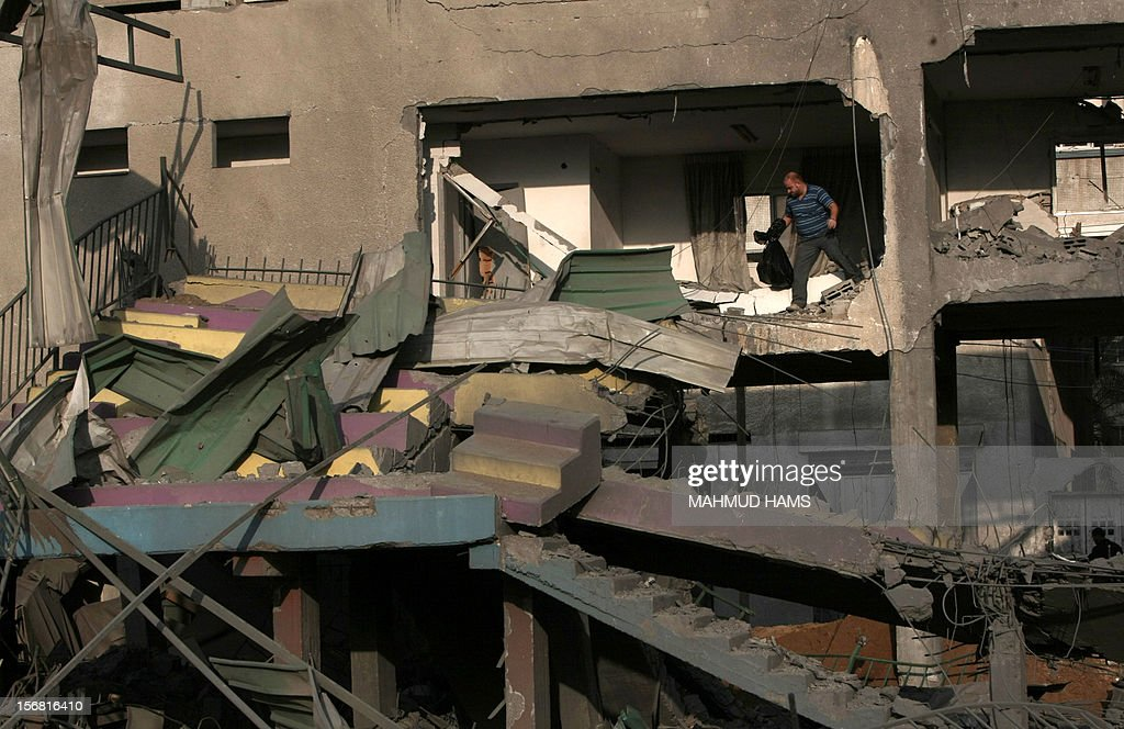 A Palestinian man inspects the debris of the destroyed Palestine Sports Stadium in Gaza City on November 22, 2012, after a ceasefire took hold in and around Gaza after a week of cross-border violence between Israel and Palestinian militants that killed at least 160 people. AFP PHOTO/MAHMUD HAMS