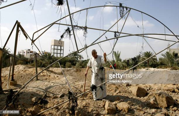 Palestinian man inspects the site of an Israeli strike ahead of the announcement of a fiveday temporary ceasefire in Khan Younis town of Gaza on...