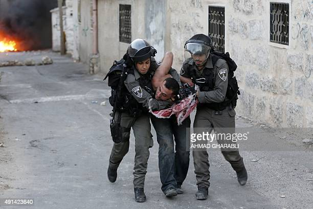 A Palestinian man is arrested by Israeli border guards during clashes with Israeli security forces in Shuafat in Israel annexed East Jerusalem on...