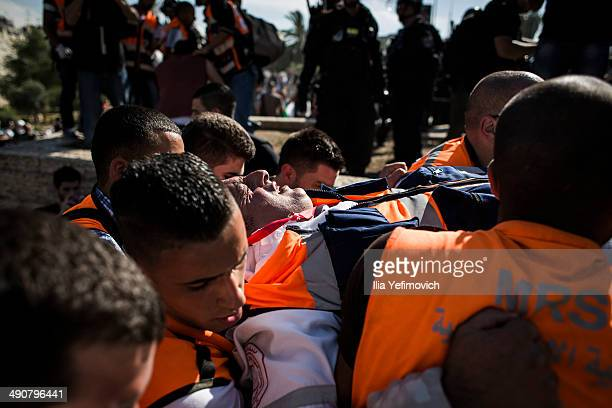 Palestinian man is carried during a rally marking Nakba day on May 15 2014 outside Damascus gate in Jerusalem Israel Palestinians mark Israel's...