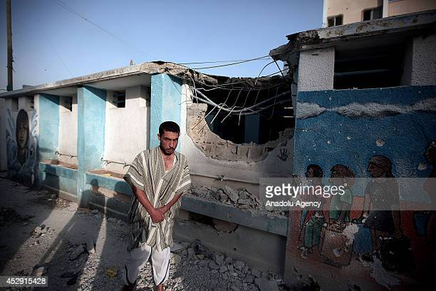Palestinian man is seen in Abu Hussein School which was sheltering dozens of displaced Palestinians run by UNRWA hit by a Israeli tank shell attack...