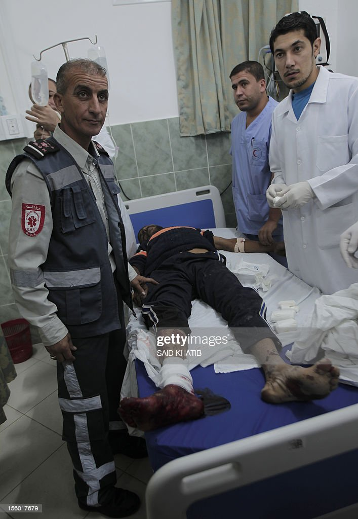 A Palestinian man is treated for his wounds following an Israeli military air strike in Rafah town in the southern Gaza Strip, on November 11, 2012. The flare-up which began November 10, was one of the most serious since Israel's devastating 22-day operation in the Gaza Strip over New Year 2009, has culminated in six Palestinians being killed and 32 injured by Israeli strikes after militants fired on an Israeli jeep, wounding four soldiers, medics and witnesses said.