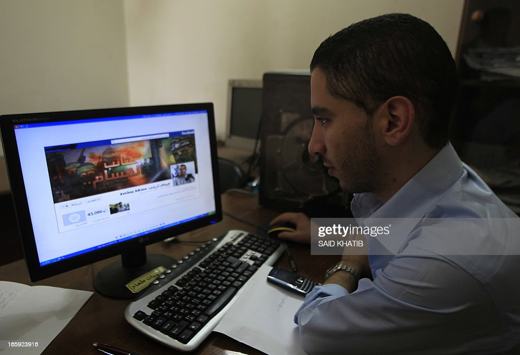 A Palestinian man looks at the Facebook page of Avichay Adraee, the spokesman of the Israeli Army to the Arabic media, after hackers replaced his cover photo with that of the Ezzedine al-Qassam Brigade during the '#Op_Israel' campaign launched by the activist group Anonymous, in Gaza City on April 7, 2013. The hackers reportedly hit several Israeli websites including that of the premier's office, the defence ministry, the education ministry and the Central Bureau of Statistics, among others, but all appeared to be running normally.