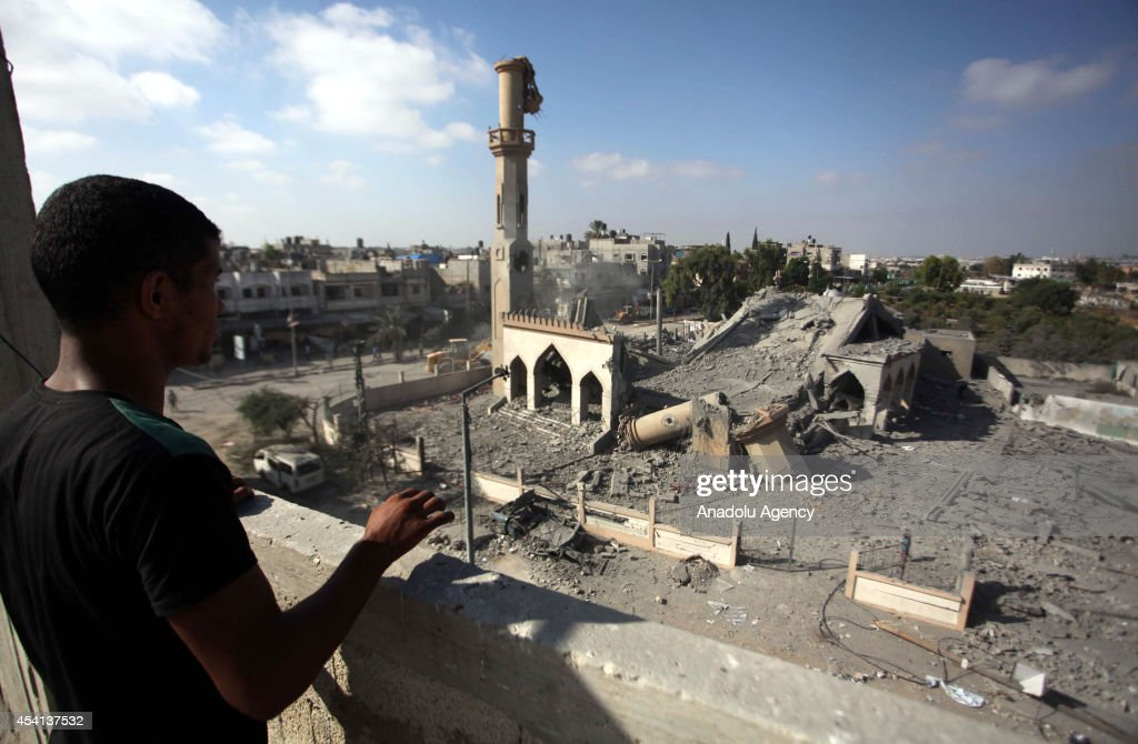 A Palestinian man looks at the rubble of Omar Ibn Abd al-Aziz mosque destroyed in an Israeli air strike in the northern Gaza Strip town of Beit Hanoun on August 25, 2014. At least 2126 Palestinians have been killed, more than 10,860 others injured and 100 mosques have been damaged in relentless Israeli attacks on the Gaza Strip since hostilities began on July 7.