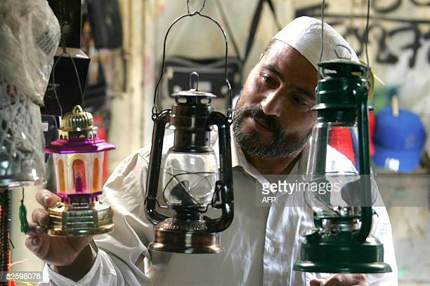 A Palestinian man looks to buy a 'Fanus Ramadan' a traditional lantern popular during the holy Muslim fasting month of Ramadan at a shop in the old...