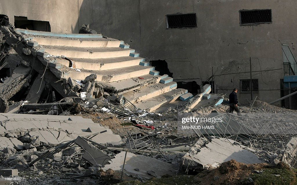 A Palestinian man makes his way through the debris of the destroyed Palestine Sports Stadium in Gaza City on November 22, 2012, after a ceasefire took hold in and around Gaza after a week of cross-border violence between Israel and Palestinian militants that killed at least 160 people.