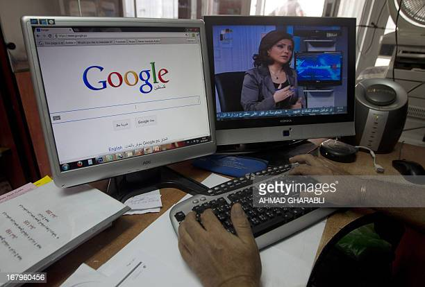 A Palestinian man opens the Palestinian homepage of Google's search engine reading in Arabic 'Palestine' at an office in Jerusalem on May 3 2013...