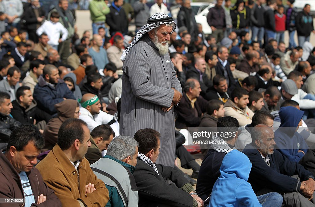 A Palestinian man performs Friday prayers in front of Ofer prison, near the West Bank city of Ramallah, prior to a demonstration in support of Palestinian detainee, Samer Issawi, who has been on hunger strike for more than 200 days, and other prisoners on hunger strike in Israeli prisons on February 15, 2013. A United Nations official on February 13, expressed concern about the wellbeing of Palestinian detainees in Israeli prisons and in particular about the condition of Issawi.