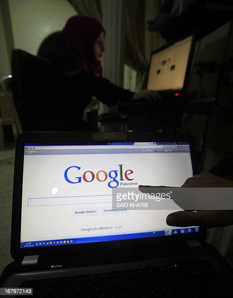 A Palestinian man points at the word 'Palestine' on the Palestinian homepage of Google's search engine in Rafah in the southern Gaza Strip on May 3...