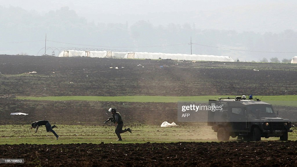 A Palestinian man runs to escape Israeli security forces at the Jalama checkpoint near the West Bank city of Jenin, on November 20, 2012, during clashes following a demonstration against the ongoing Israeli military offensive on the Gaza Strip. Clashes erupted as thousands of Palestinians marched demanding revenge for the killing of a Palestinian protester the day before.