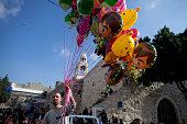 Palestinian man sells balloons outside the Church of the Nativity on December 24 2014 in Bethlehem West Bank Every Christmas pilgrims travel to the...