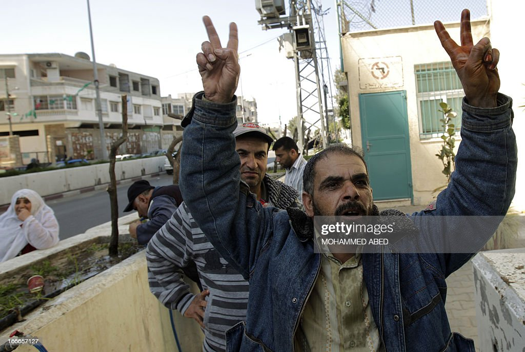A Palestinian man shouts slogans during a protest by more than a hundred refugees outside the offices of the United Nations Relief and Works Agency (UNRWA) in Gaza City in demand of undelivered aid supplies on April 15, 2013. The United Nations reopened last week aid distribution centres in Gaza, after a four-day closure in response to the storming of its offices by protesters demanding reinstatement of a monthly cash allowance to poor families which was halted from April 1 due to budget cuts.