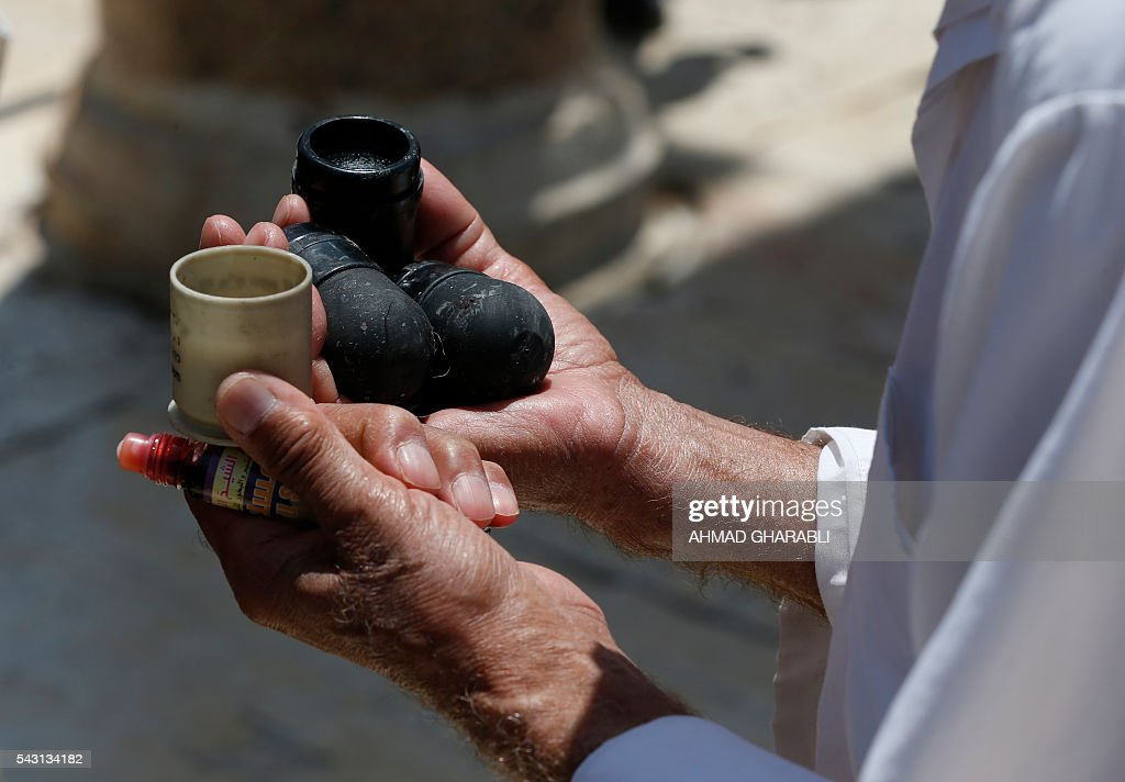 A Palestinian man shows foam-tipped bullets reportedly used by Israeli riot police outside the Dome of the Rock in Jerusalem's Al-Aqsa mosque compound after clashes erupted at the site between Palestinians and Israeli police on June 26, 2016 during the holy month of Ramadan. Israeli police at Jerusalem's Al-Aqsa mosque compound clashed with Muslims protesting Jewish visits there as the Islamic holy month of Ramadan approached its climax, Palestinians said. / AFP / AHMAD