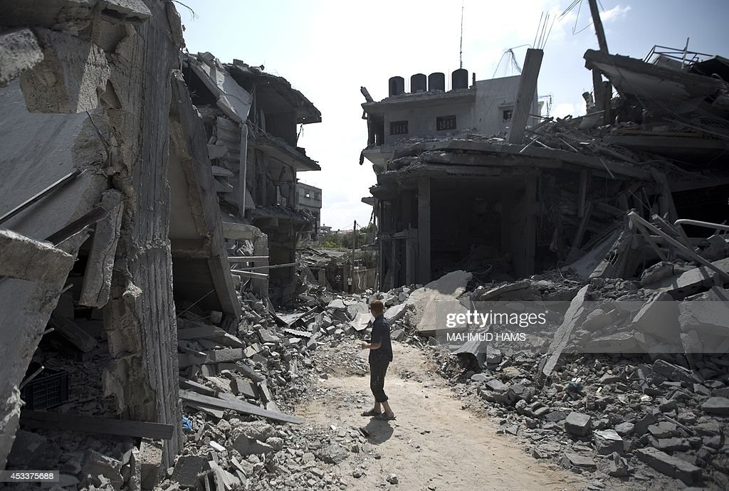 A Palestinian man stands amid the rubble of buildings following an Israeli military strike in the Jabalia refugee camp in the northern Gaza Strip on...